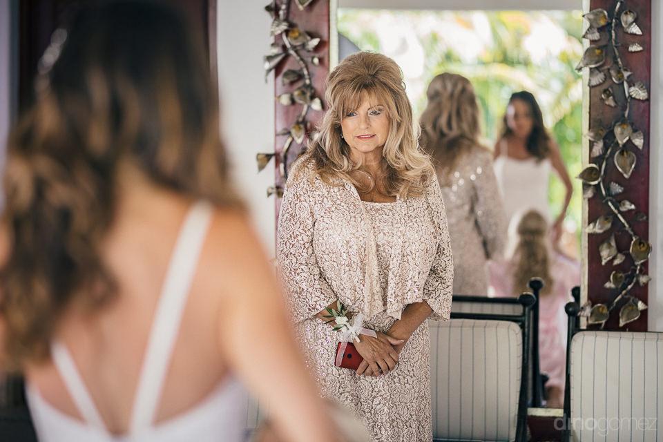 adoring mom watches bride get ready morning of wedding in los ca