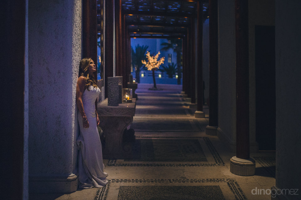 bride alone in hallway at night artistic photo by dino gomez
