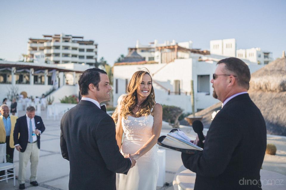 luxury wedding ceremony at las ventanas at sunset photos by dino