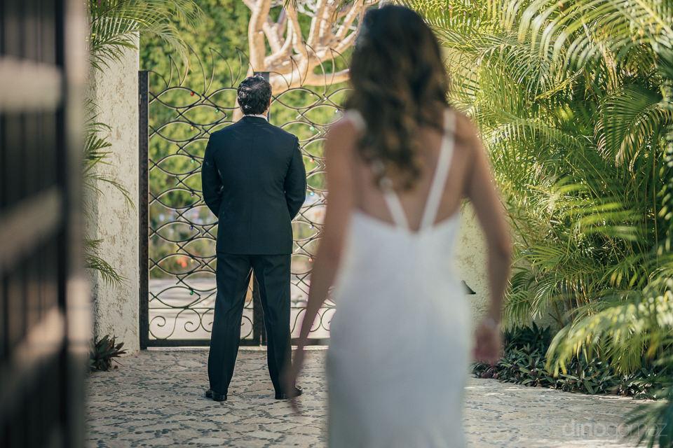 bride walks up to groom from behind at las ventanas al paraiso r