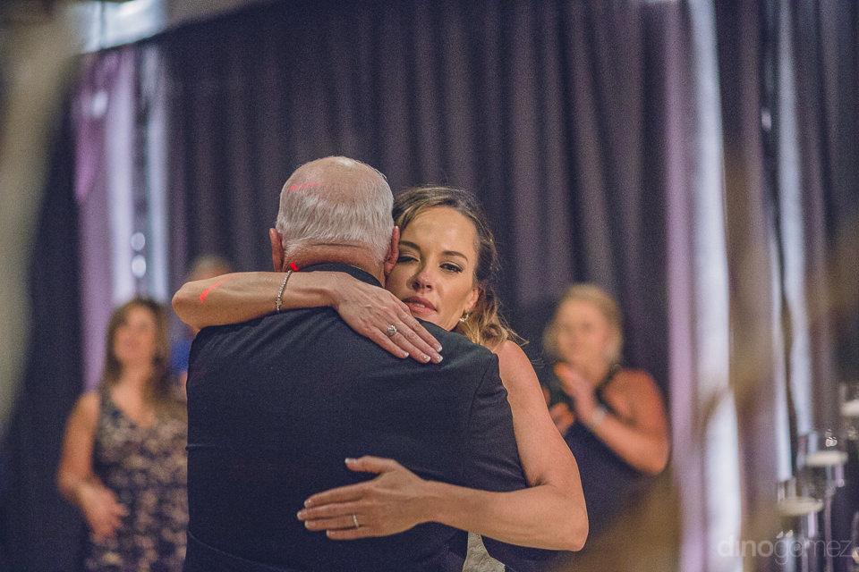 heartwarming scene at destination wedding bride hugs father