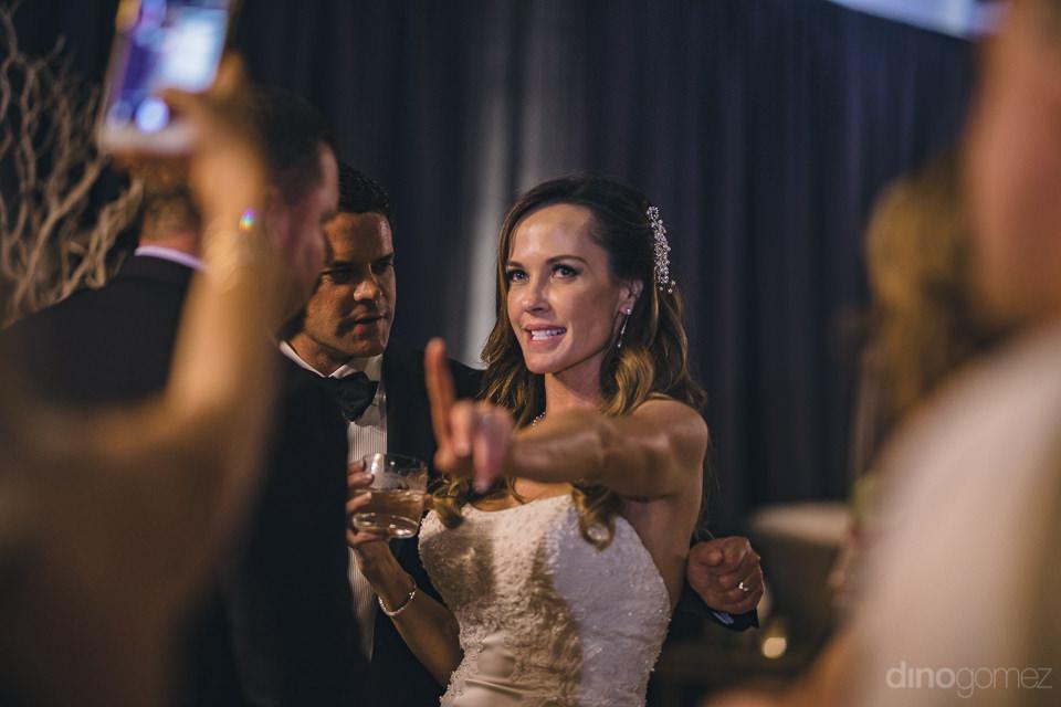 bride has fun at her wedding reception in los cabos photo by din