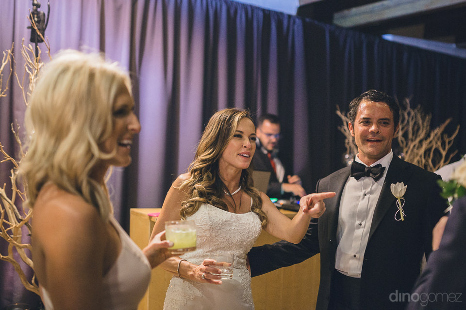 newlyweds and guests party after luxury wedding ceremony at las