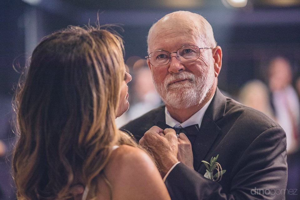 bride and father are very happy at wedding in los cabos