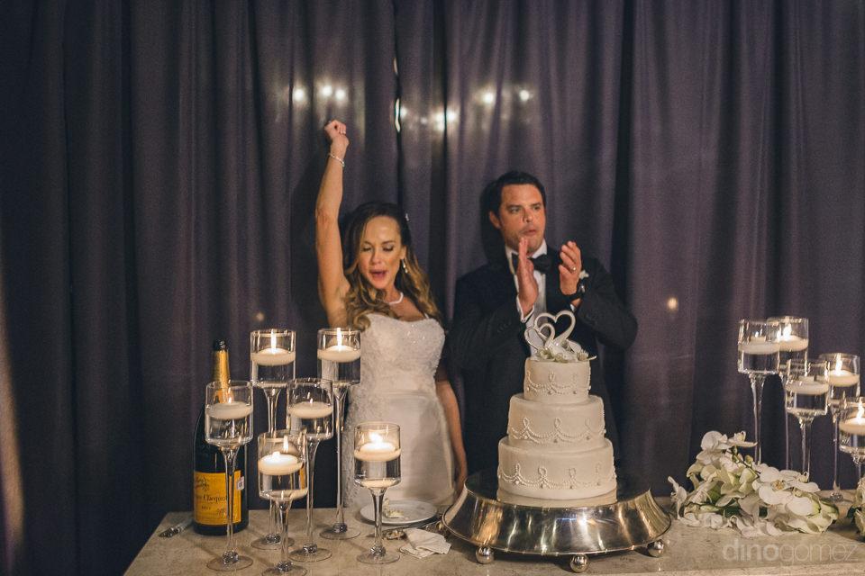 amazing wedding cake newlyweds at high-end wedding reception pho