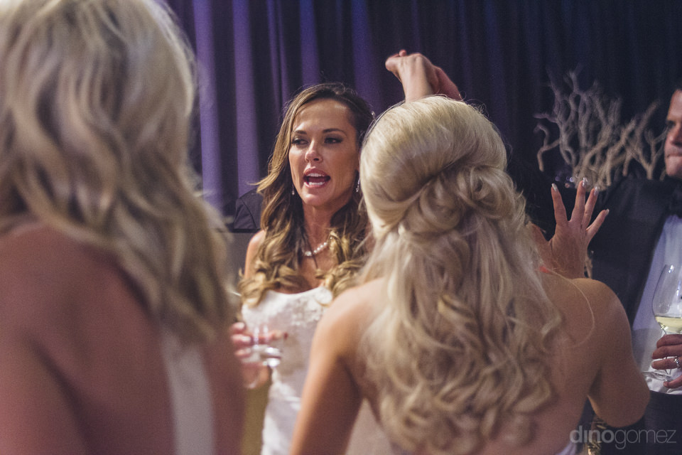 bride is center of attention at wedding reception in los cabos