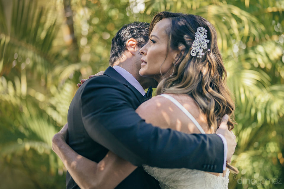 dino gomez photo of loving couple hugging on wedding day in los