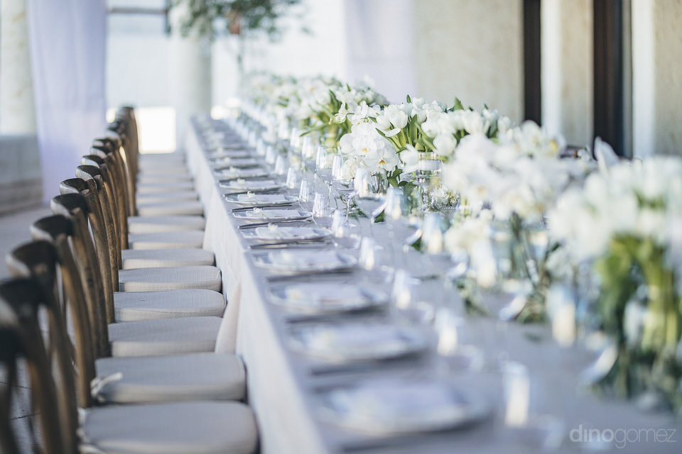 dinner table with luxury florals by cabo floral studios photos b