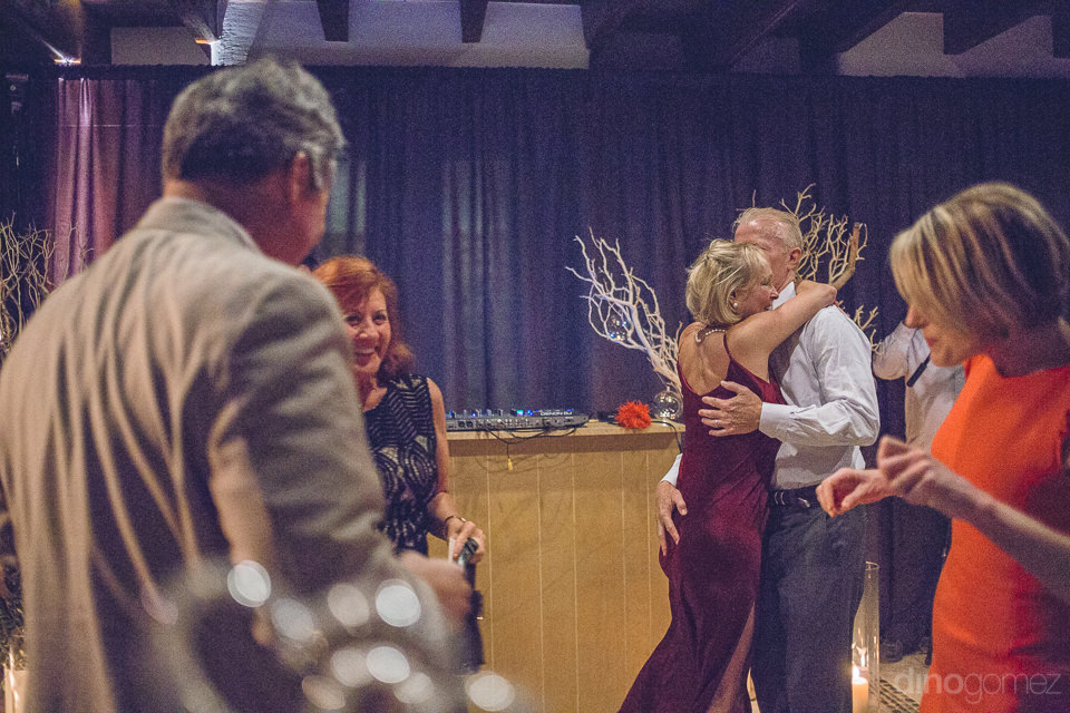 guests dance and party at luxury wedding reception in cabo
