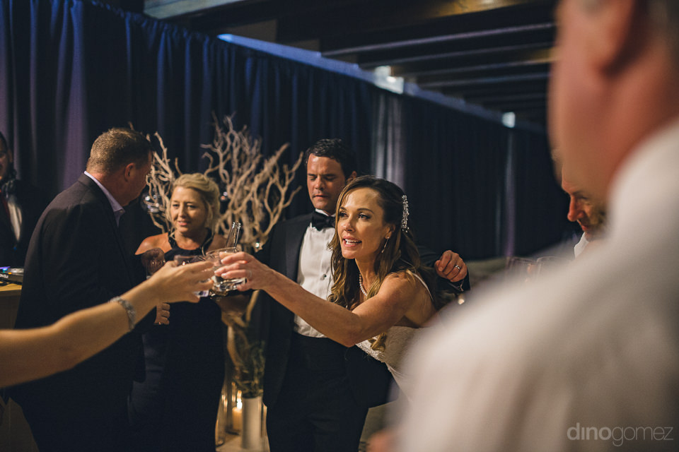 happy guests with newlyweds at luxury wedding reception with pho