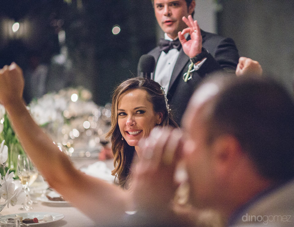 newlyweds celebrate with guests at luxury wedding reception in c
