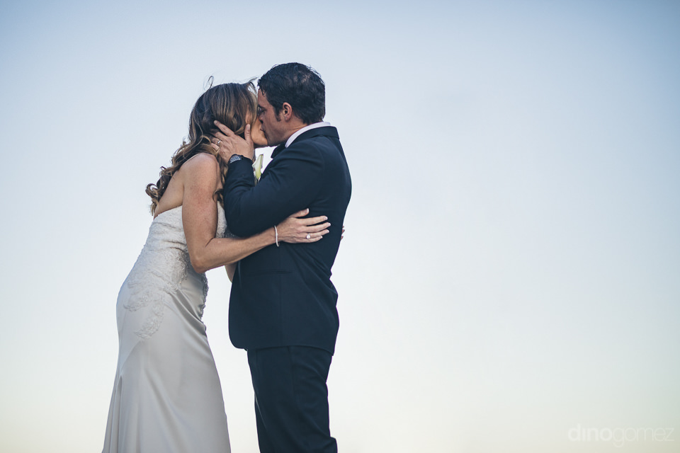 newlyweds kiss married in cabo luxury wedding photographer dino