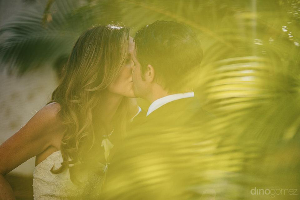perfect cabo luxury wedding newlyweds kiss in paradise