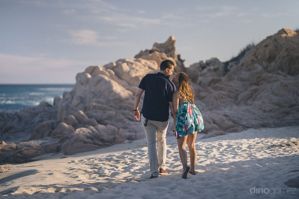 secluded beach near cabo young engaged couple in photo session w