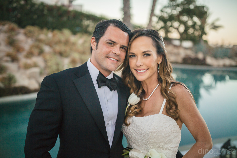 newlyweds pose for photo by professional cabo photographer dino