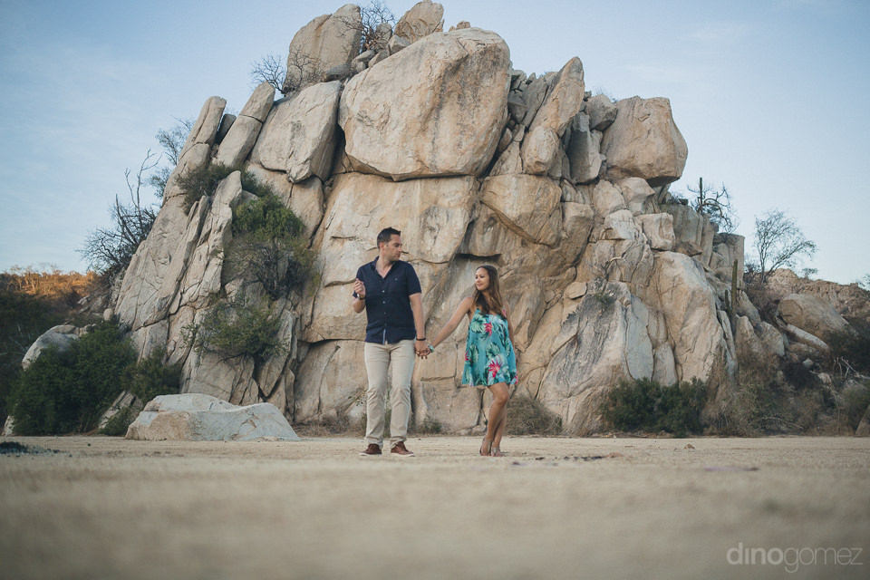 artistic and fun engagement photo session on the beach