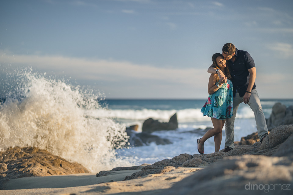 beach photo session with engaged couple in los cabos by dino gom