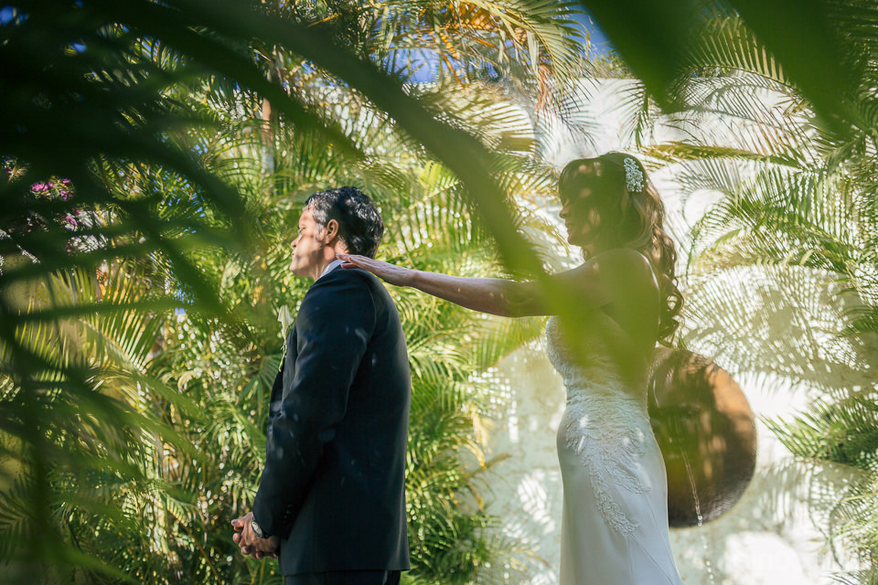 bride and groom together in mexico paradise resort photo by dino