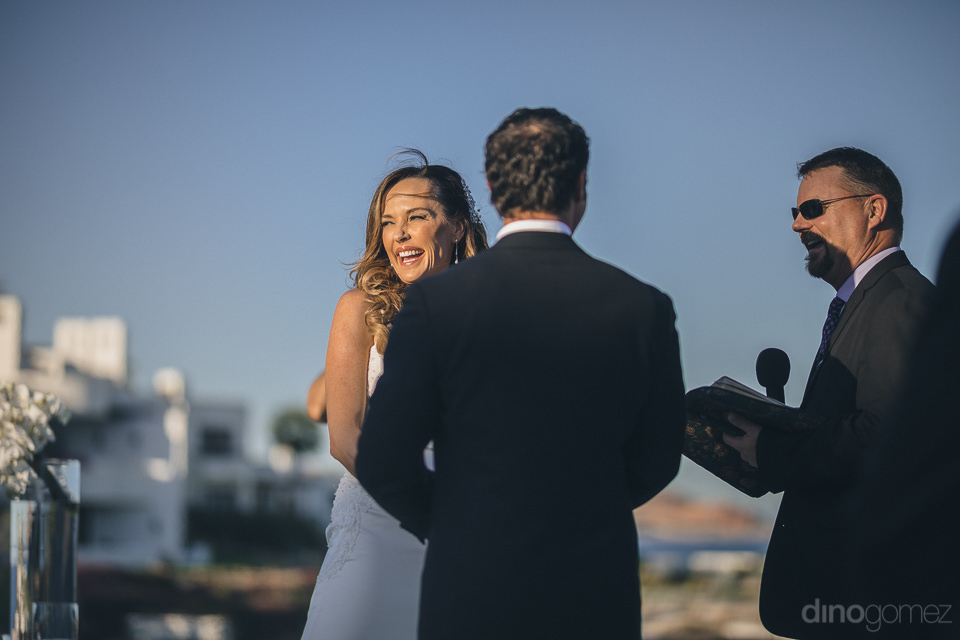 bride and groom laugh and smile at wedding ceremony organized by