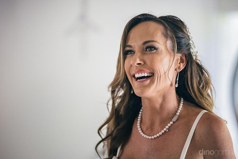 bride smiles looks beautiful before luxury cabo wedding photogra