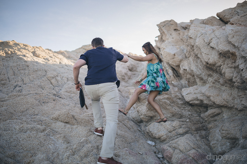fun engagement photo session on beach rocks in cabo young engage