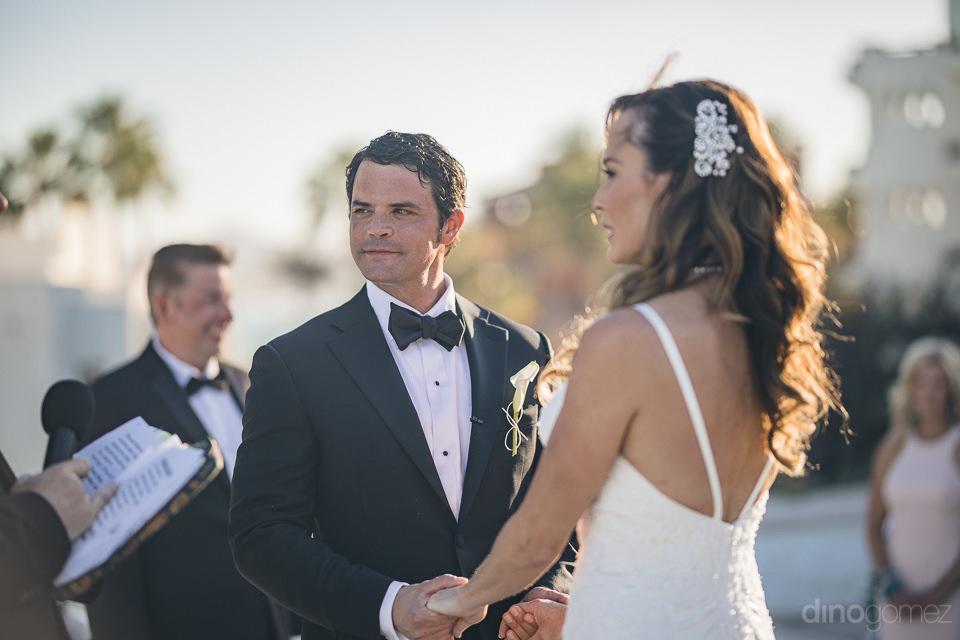 destination wedding ceremony bride groom standing at altar photo
