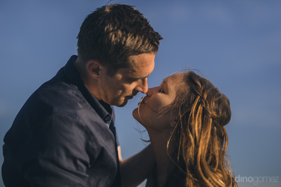 romantic engagement photo couple kissing on the beach