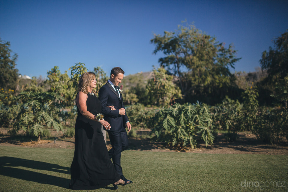 best cabo wedding venue flora farms groom walks down aisle with