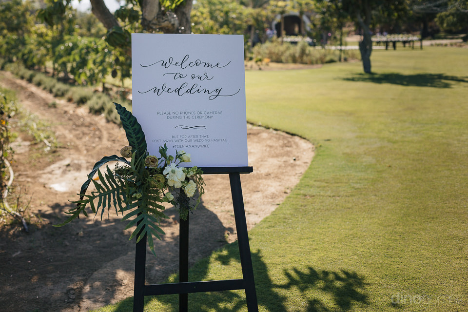 sign welcoming guests to wedding at beautiful boutique organic f
