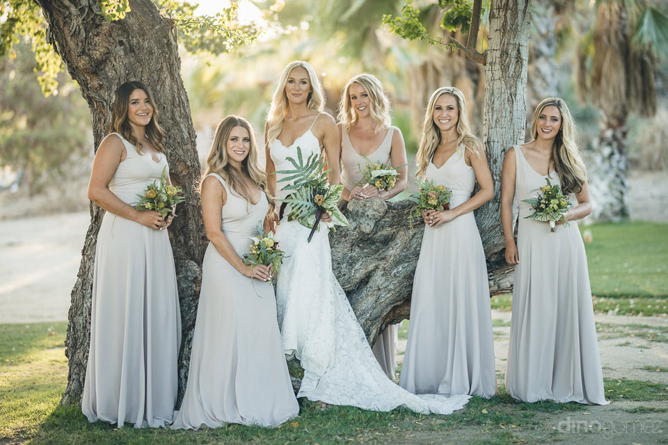 beautiful bride and bridesmaids pose for photographer dino gomez