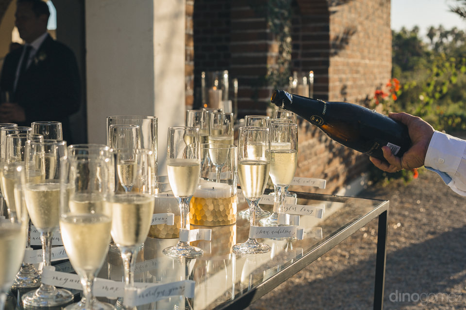 glasses are filled with champagne at the start of the wedding re