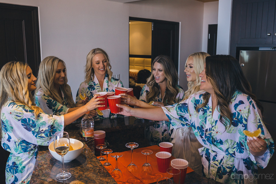 bride bridesmaids cheers toast drink tequila in hotel room kitch