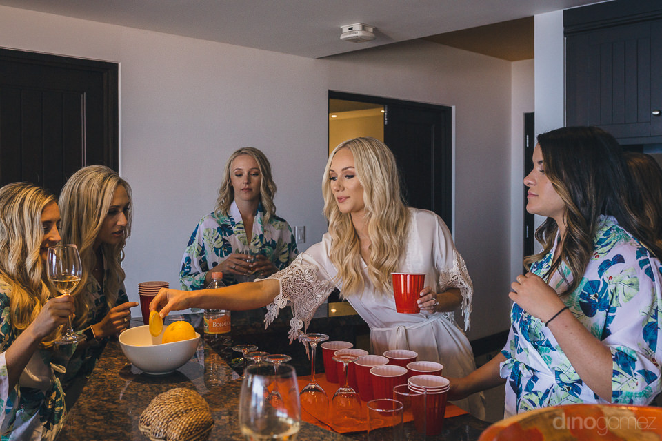 bride and bridesmaids drink tequila morning before los cabos des