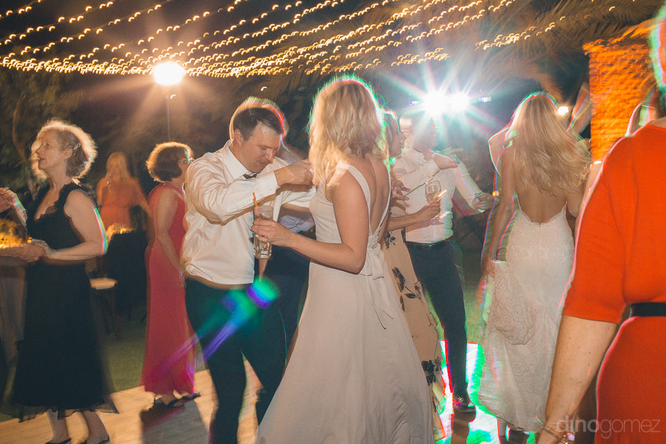 guests and newlyweds dance and party at luxury cabo wedding at f
