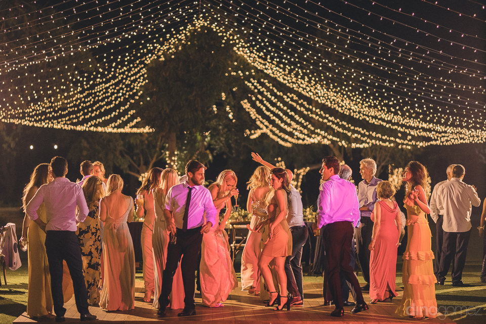 all guests on dance floor at flora farms luxury wedding receptio
