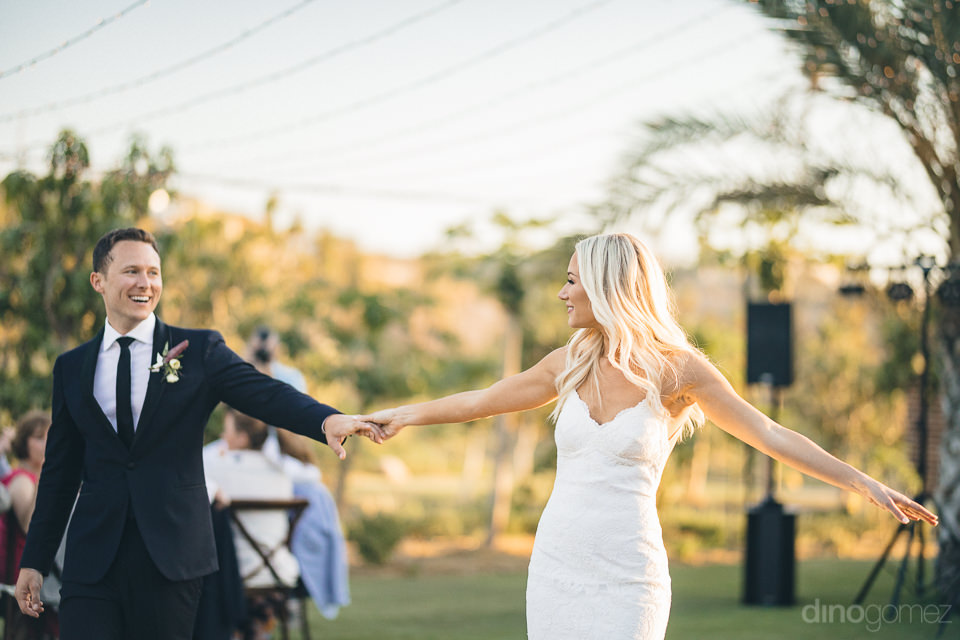 newlyweds have first dance at sunset at luxury flora farms weddi
