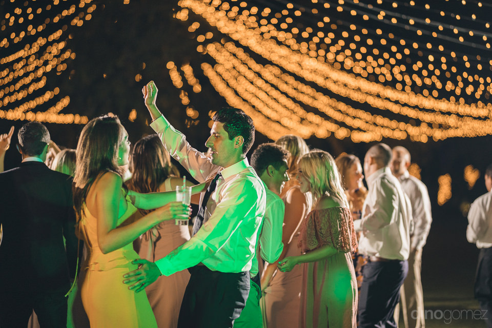 guests dance and party at flora farms wedding reception in los c