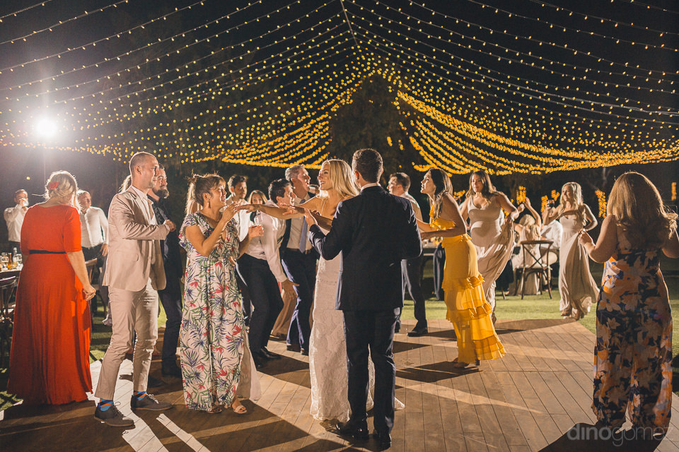 guests join bride and groom on dance floor at flora farms weddin