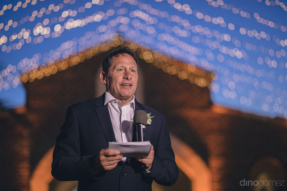 wedding guests give speeches during dinner at flora farms