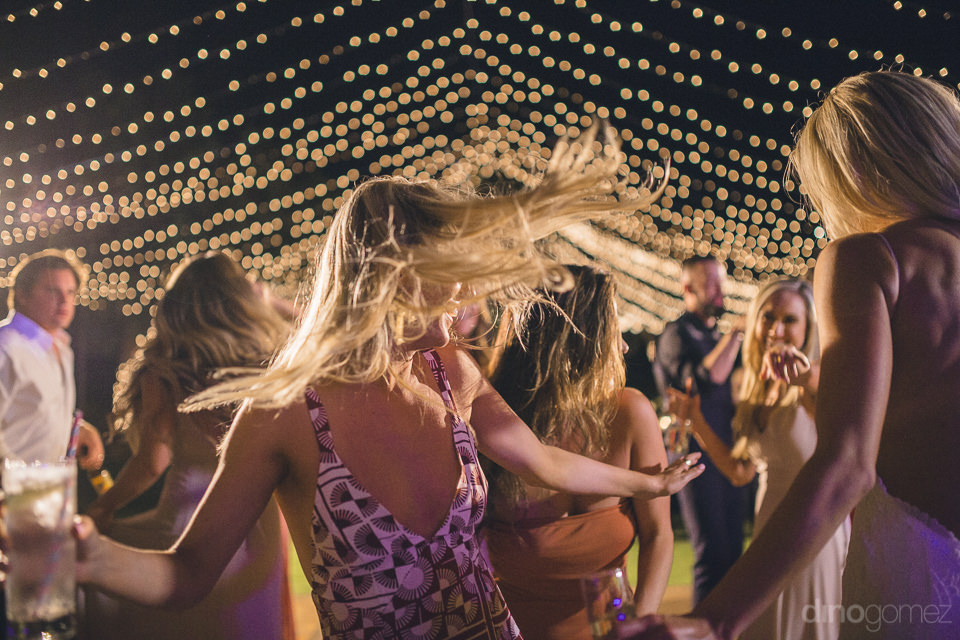 guests party hard at fun flora farms wedding reception photograp