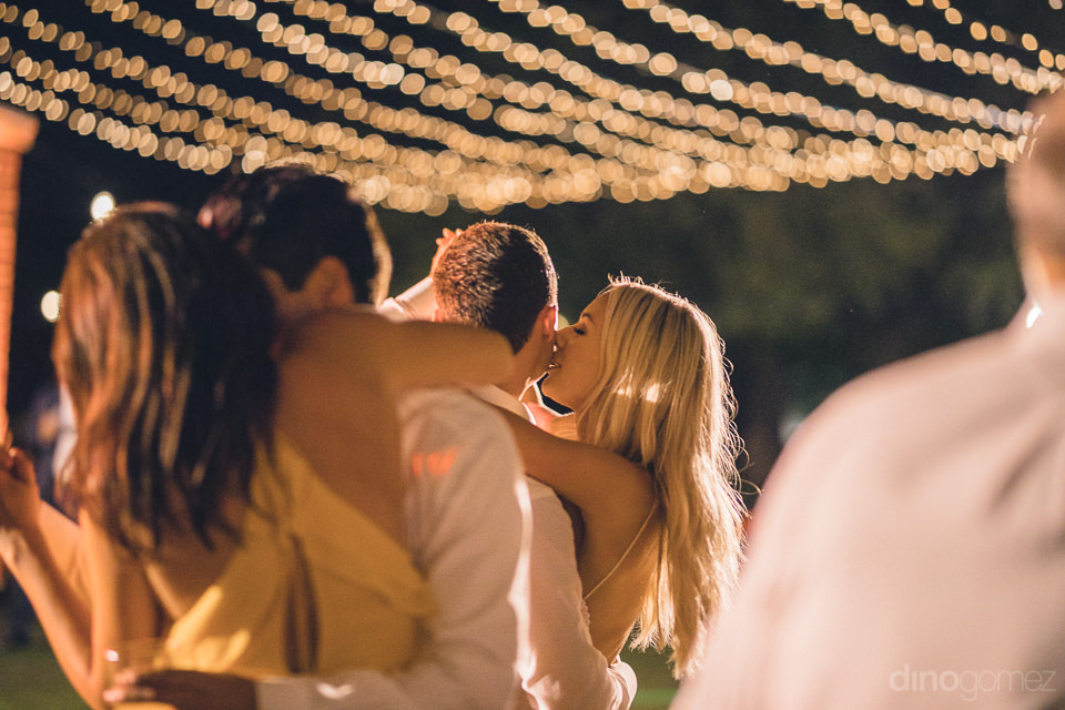newlyweds kiss on the dance floor at reception at flora farms