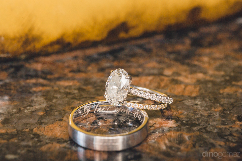 luxury diamond wedding rings for bride and groom in photo by cab
