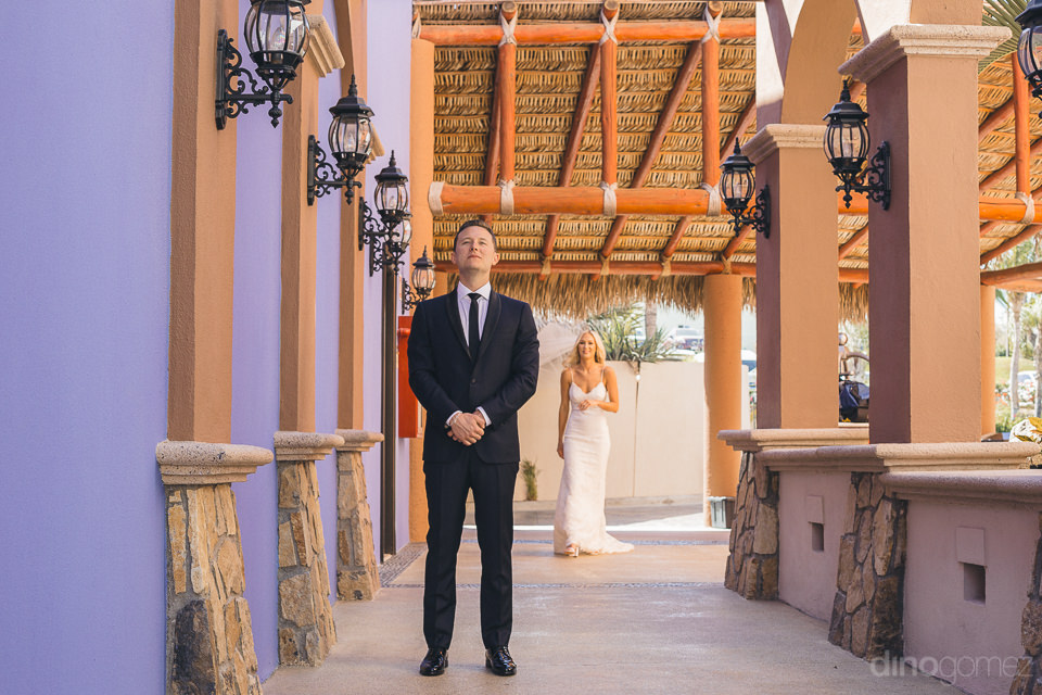 bride walks up to groom at mexican villa on wedding day in cabo