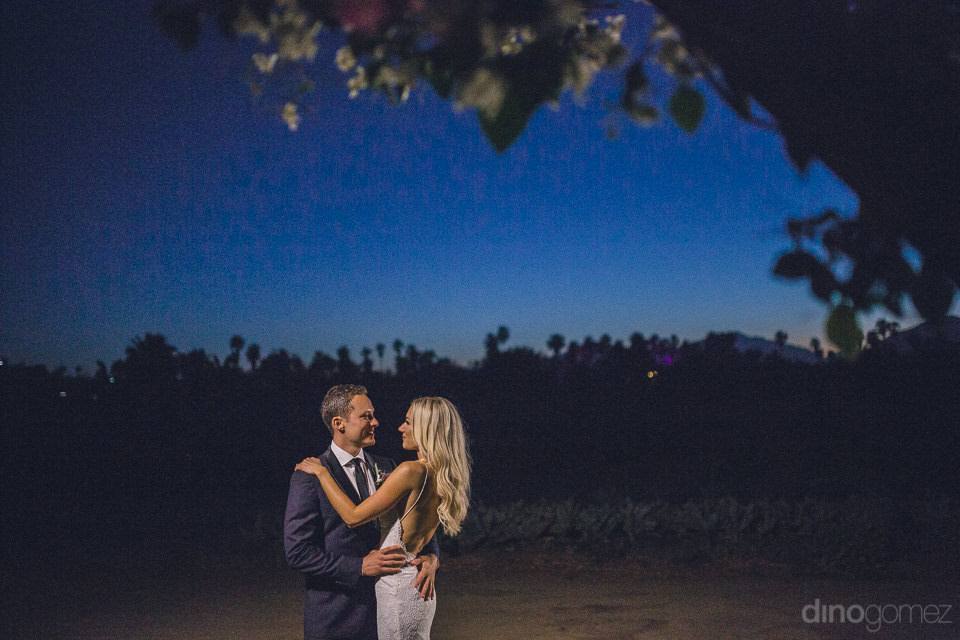 night time falls upon farm wedding newlyweds alone in field