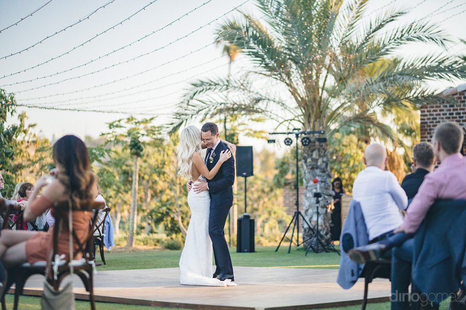 outdoor farm wedding first dance of newlyweds cabo photographer