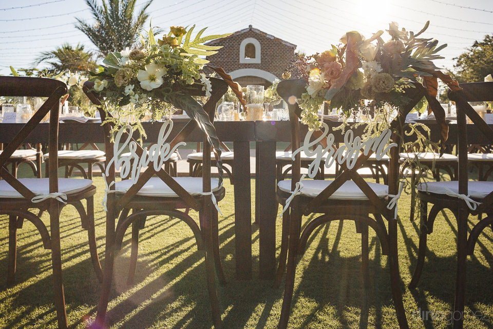 pina hernandez florals on bride and groom chairs at dinner table