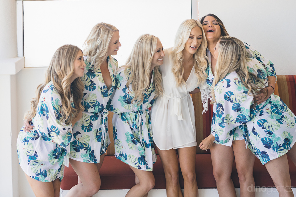 bride with bridesmaids in robes before wedding in cabo photo by