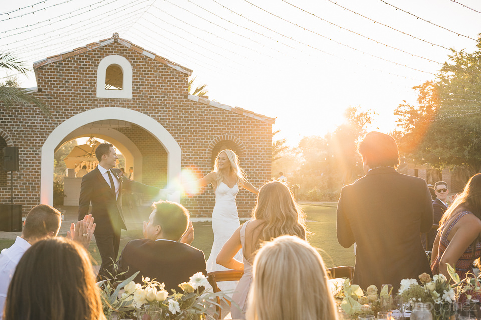 newlyweds dance at sunset at flora farms romantic wedding photo