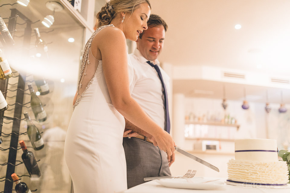 low angle of Kara and Will cutting the cake