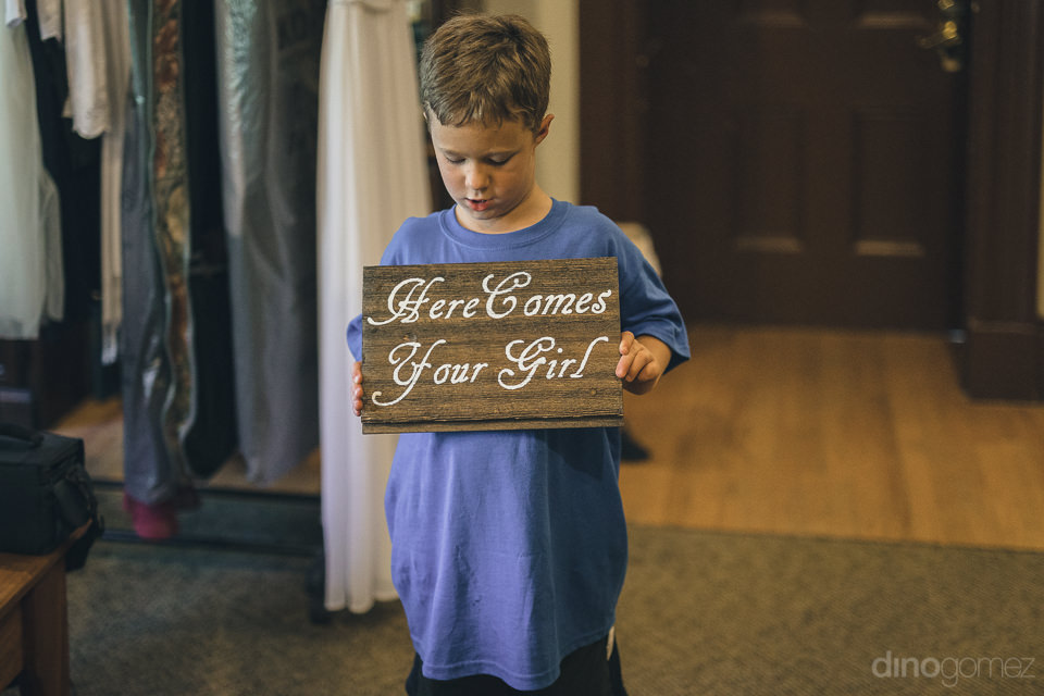 young boy holding cute sign on wedding day in new york state